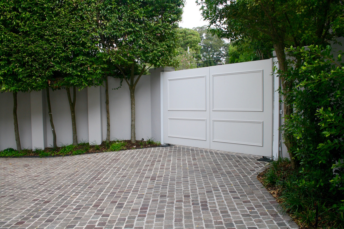 Porphyry Cobblestone driveway by Legacy Property Holdings